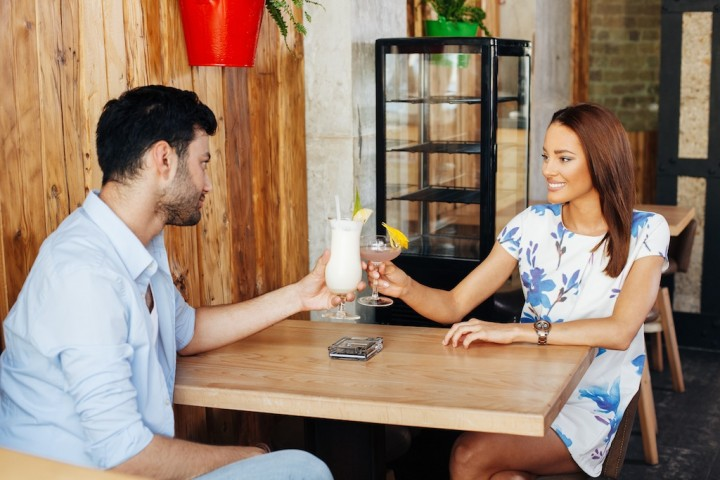 Young couple dating in the cafe