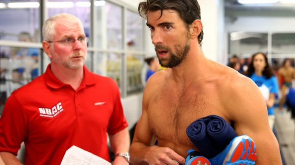 CHARLOTTE, NC - MAY 16: (L-R) Coach Bob Bowman and Michael Phelps talk after his swim in the men's 100m butterfly final during day 1 of the Arena Grand Prix at Charlotte at Mecklenburg County Aquatic Center on May 16, 2014 in Charlotte, North Carolina. (Photo by Streeter Lecka/Getty Images)