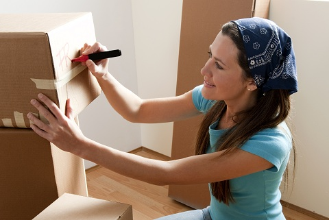 woman-labeling-packed-box_shutterstock_66379999